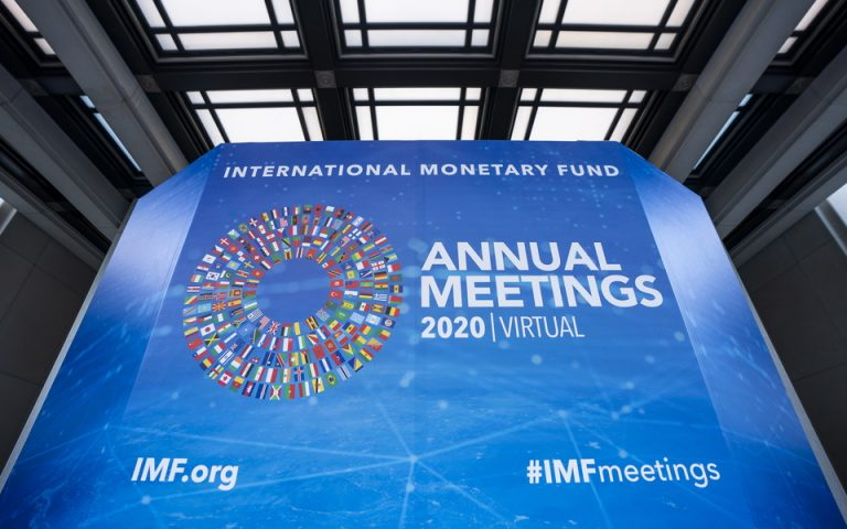 epa08743973 Signs for the International Monetary Fund (IMF) World Bank Group 2020 annual fall meeting, which has gone virtual due to the Coronavirus pandemic, outside IMF headquarters in Washington, DC, USA, 14 October 2020.  EPA/JIM LO SCALZO