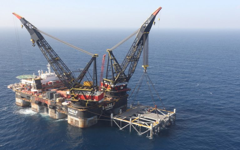 epa08716985 (FILE) - An aerial view of SSCV Thialf, the largest crane vessel in the world, at the Leviathan gas platform of Noble Energy at the Mediterranean Sea, some 10 km from the Israeli coast, 31 January 2019, after the foundations of a 98-meter-tall and 15,500-ton-weighing metal structure (R) were lowered onto the sea bed from aboard a large barge late 30 January 2019 (reissued 03 October 2020). Media reports on 03 October 2020 state shareholders of Houston-based Noble Energy on 02 October 2020 agreed to a takeover deal of Chevron Corp., of purchasing Nobel Energy in an all-stock agreement valued at some 4.1 billion USD.  EPA/MARC ISRAEL SELLEM / POOL *** Local Caption *** 55103860