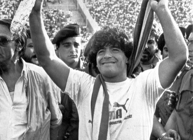 epa08841968 (FILE) - A picture dated 05 July 1984 showing Diego Aramando Maradona of Argentina waving to fans during his presentation as new signing for Italian Serie A club Napoli. Diego Maradona has died after a heart attack on 25 November 2020.  EPA/ANSA