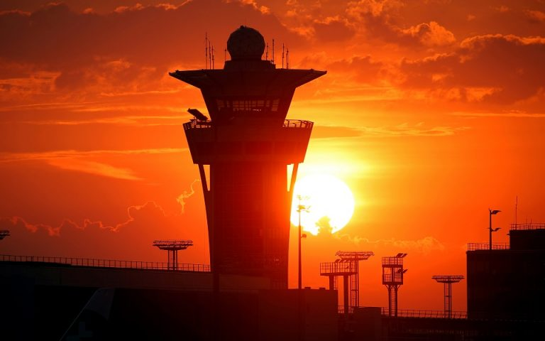 FILE PHOTO: The control tower is seen at sunrise as Paris' Orly Airport reopens following the coronavirus disease (COVID-19) outbreak in France, June 26, 2020. REUTERS/Charles Platiau/File Photo