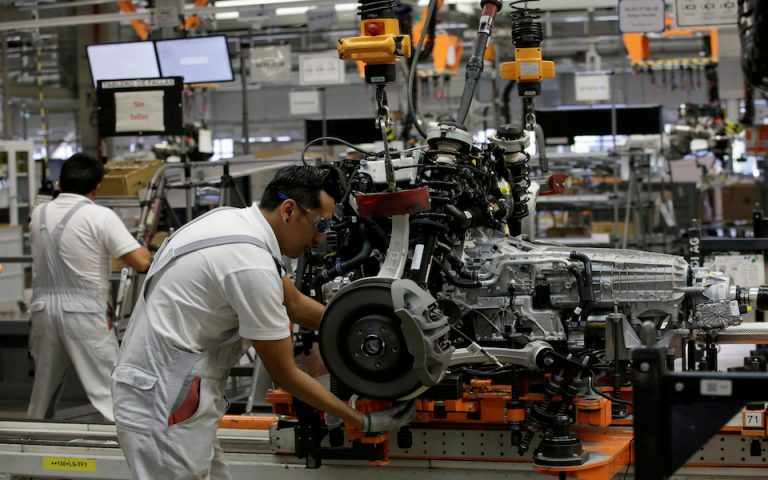 FILE PHOTO: Employees works at an Audi Q5 2.0 production line of the German car manufacturer's plant during a media tour in San Jose Chiapa, Mexico April 19, 2018. REUTERS/Henry Romero/File Photo