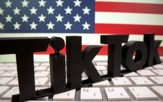 FILE PHOTO: A 3D printed Tik Tok logo is placed on a keyboard in front of U.S. flag in this illustration taken October 6, 2020. Picture taken October 6, 2020. REUTERS/Dado Ruvic/Illustration/File Photo