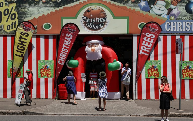 People enter and exit a Christmas World shop as coronavirus disease (COVID-19) regulations are further eased for the state of New South Wales in Sydney, Australia, November 26, 2020.  REUTERS/Loren Elliott