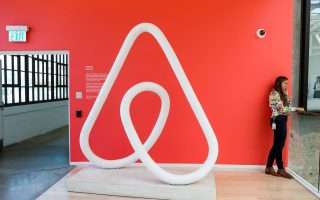 FILE PHOTO: A woman talks on the phone at the Airbnb office headquarters in the SOMA district of San Francisco, California, U.S., August 2, 2016.  REUTERS/Gabrielle Lurie/File Photo