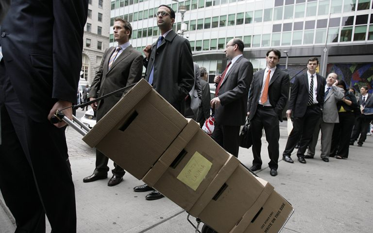 A man with boxes of documents related to the Chrysler bankruptcy case, waits in line to enter Bankruptcy Court in New York, Wednesday, May 27, 2009.  (AP Photo/Seth Wenig)