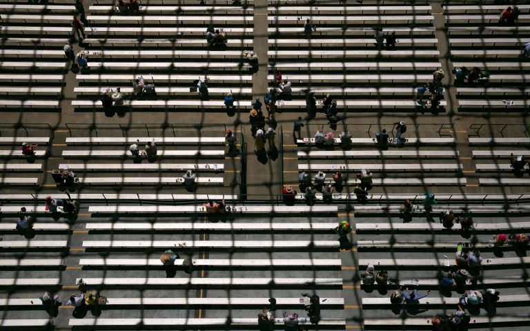 Spectators seat spaced apart following Churchill Downs restrictions due to the coronavirus disease (COVID-19) pandemic on the day of the 147th Kentucky Derby in Louisville, Kentucky, U.S. May 1, 2021. REUTERS/Amira Karaoud