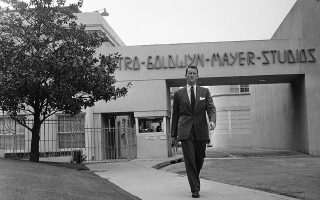 Samuel Goldwyn, Jr., poses outside the main gate at Metro-Goldwyn-Mayer studios in Hollywood, Calif., April 22, 1959. The younger Goldwyn is not a figure with MGM. (AP Photo/Ellis R. Bosworth)